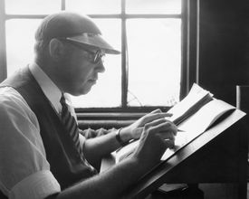 Black and white image of a copyeditor working in profile.