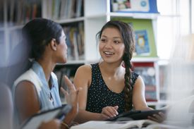two female students chatting