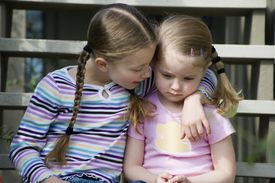 Older sister talking to younger sister.
