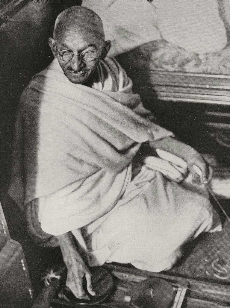 Mahatma Gandhi in robes sitting