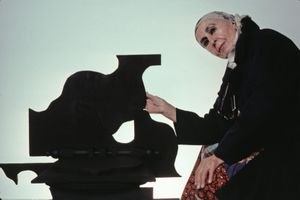 Sculptor Louise Nevelson with her work