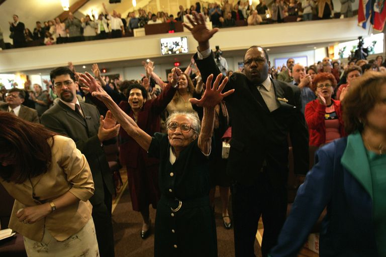 Members of The Bay Ridge Christian Center Pentecostal Church pray during a two-hour English language church service on April 10, 2005 in Brooklyn, New York city.