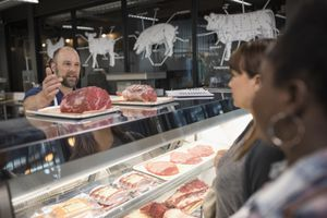 Butcher with raw meat