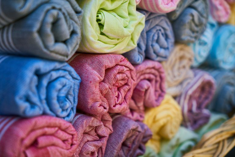 Rolls of different colored textiles.