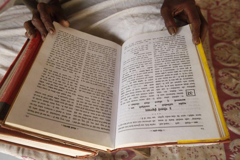 Temple priest reading the Bhagavad Gita