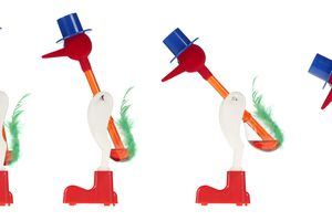The drinking bird features a glass bird that dips its beak into water.