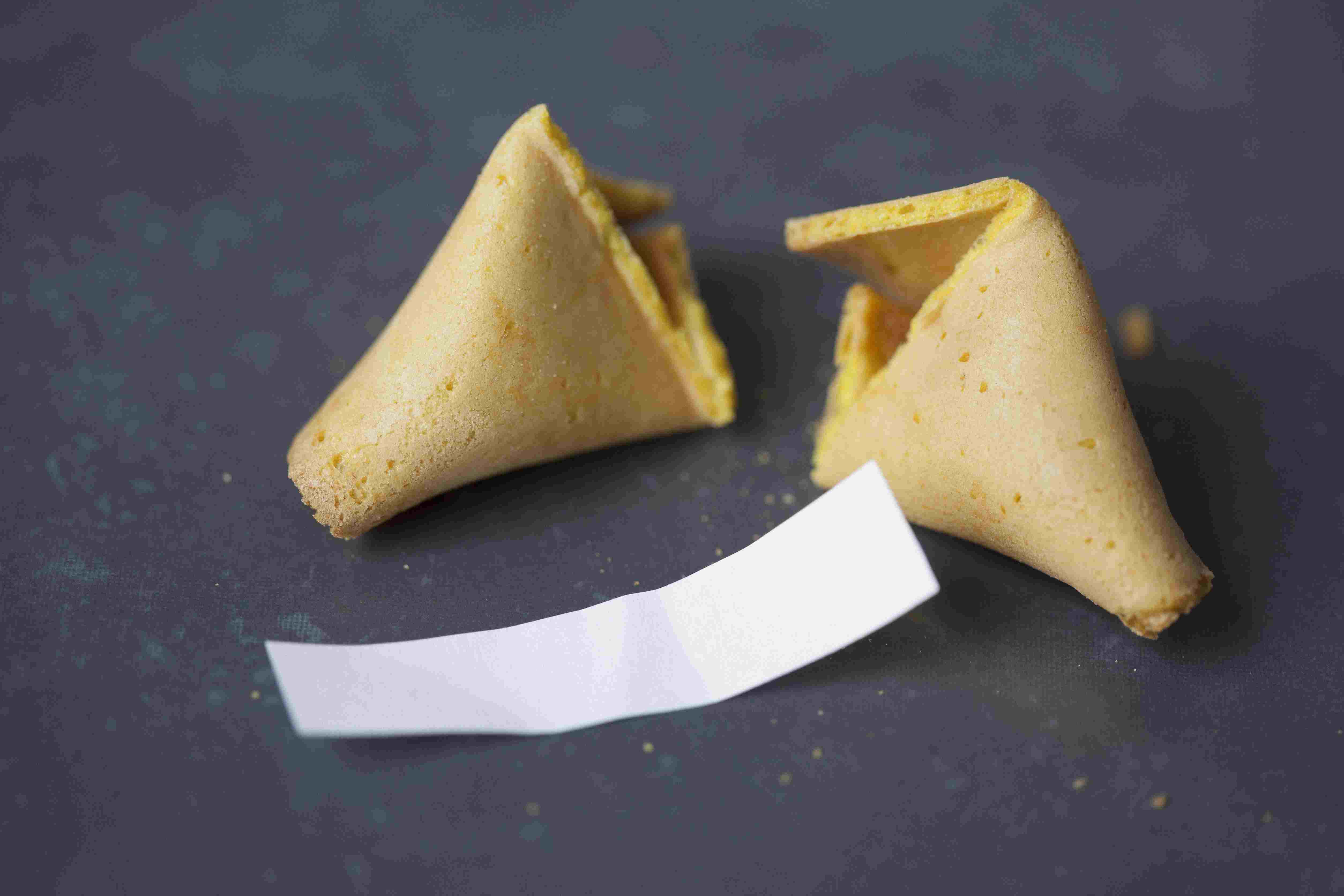 Broken fortune cookie on table
