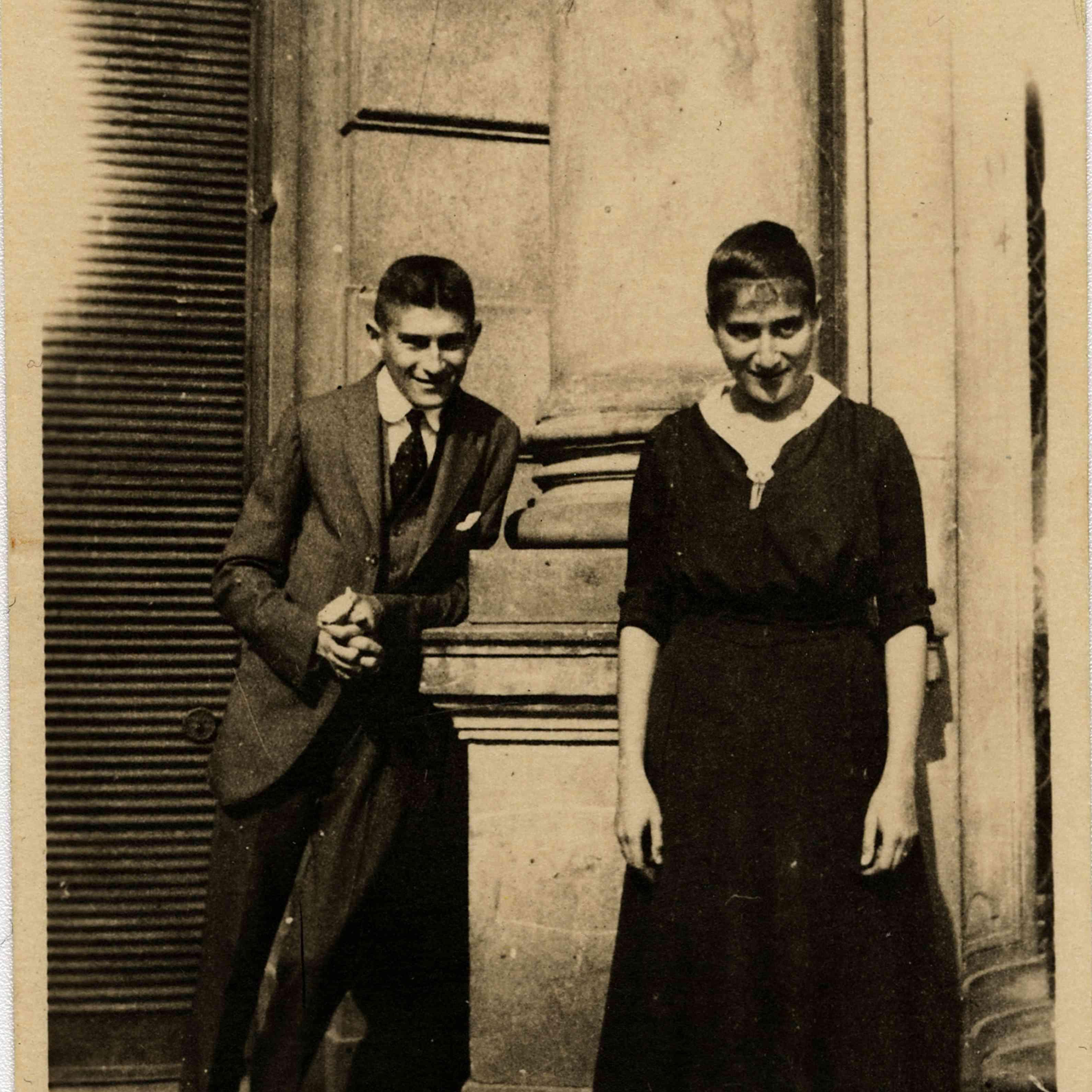 Franz Kafka with his sister Ottla before Oppelt House in Prague Artist: Anonymous