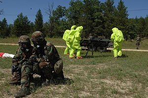 Soldiers wearing JSLIST and performing evacuation exercise