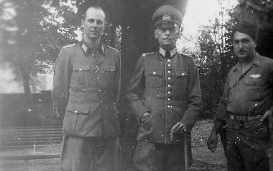 Gerd von Rundstedt standing between his son Hans and an unidentified soldier.