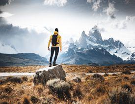 man standing on rock in the El Chaltén region of Argentina.
