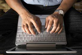Man working on laptop computer