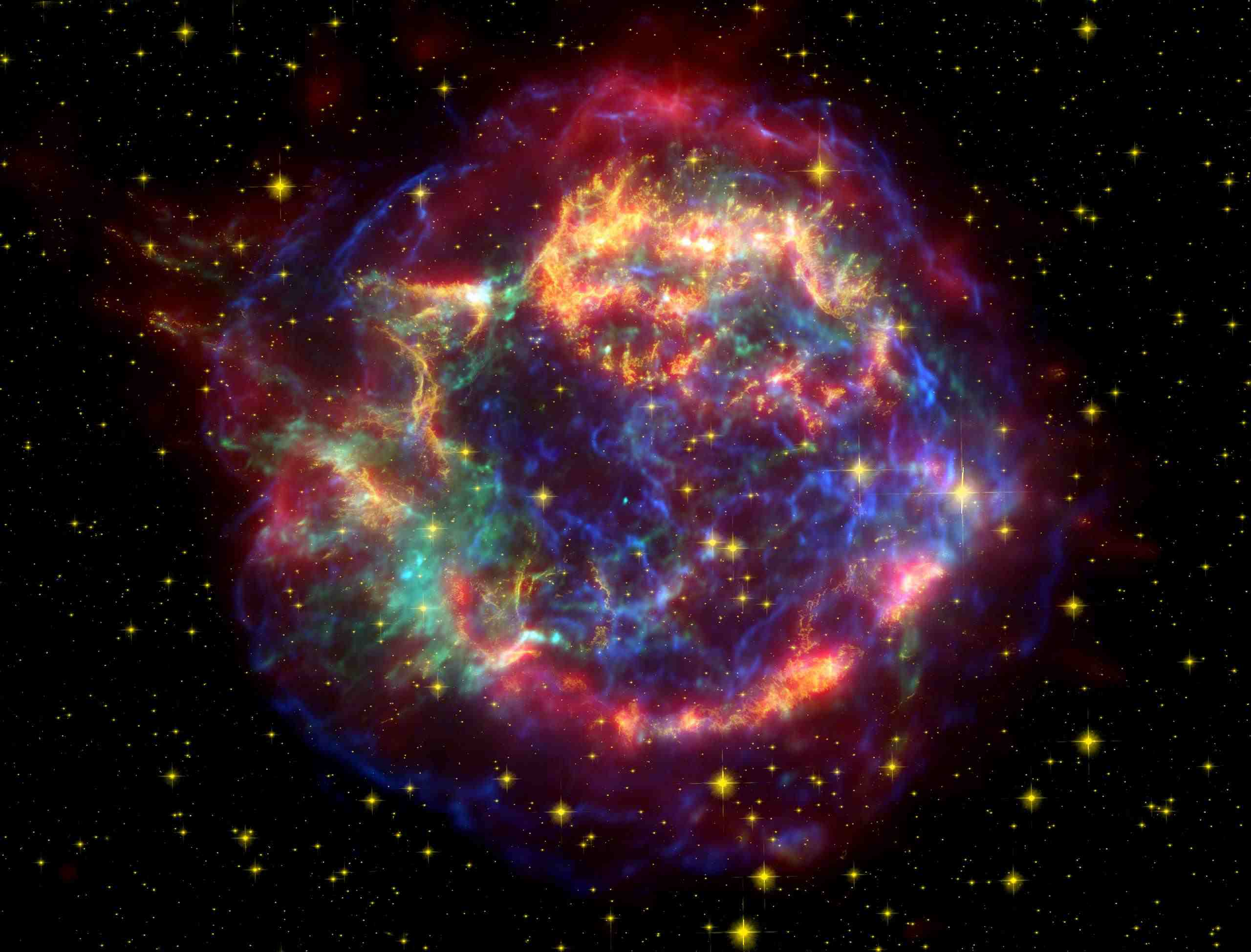 A false color image of Cassiopeia A (Cas A) using observations from both the Hubble and Spitzer telescopes as well as the Chandra X-ray Observatory.