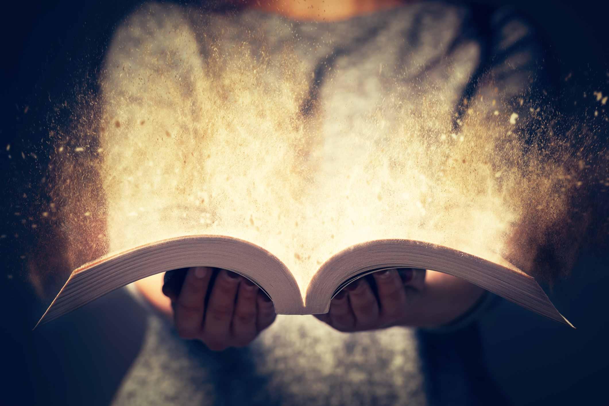 an open book bursting with light