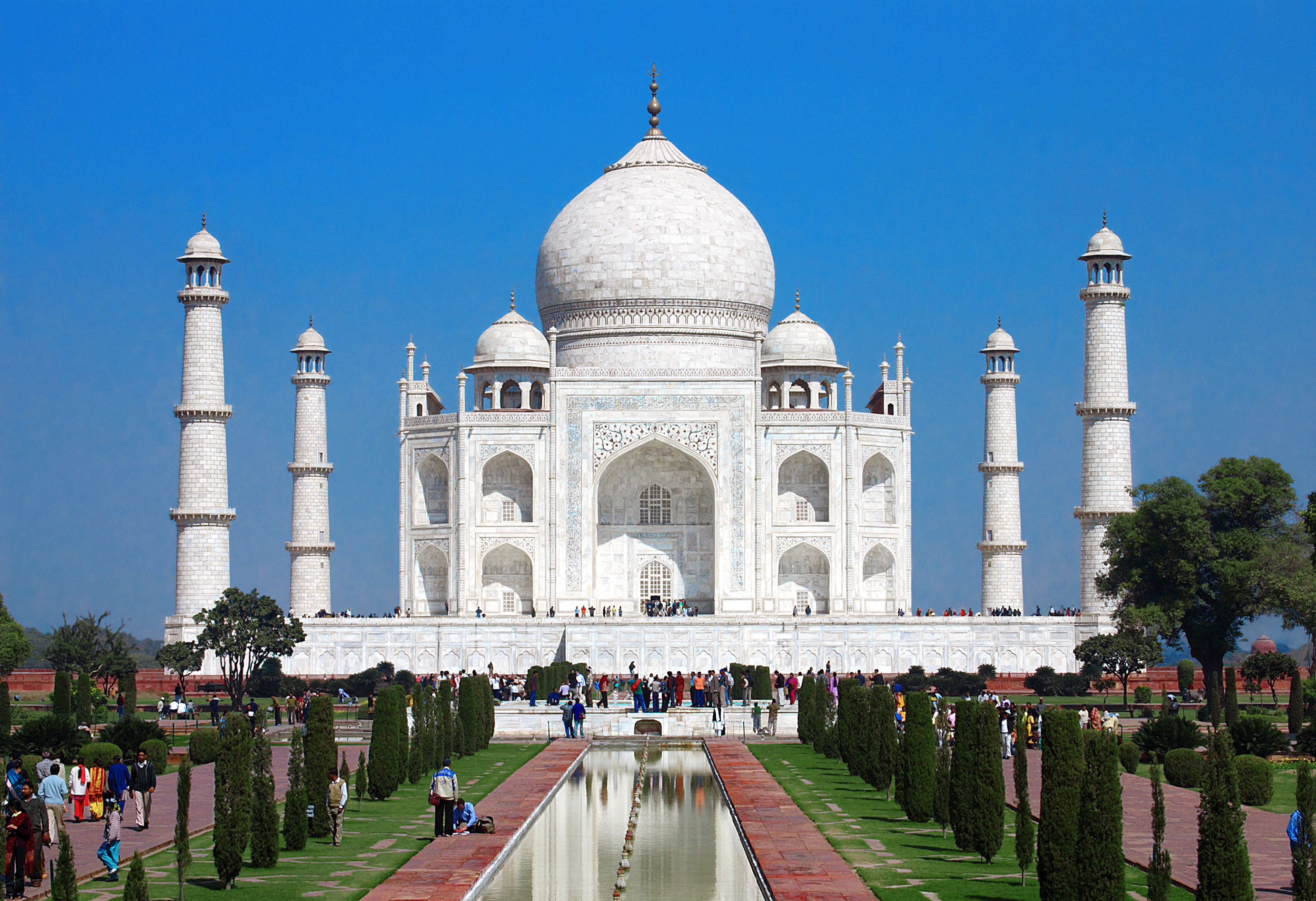 Bright white ivory marble of the Taj Mahal in India, symmetrical photo