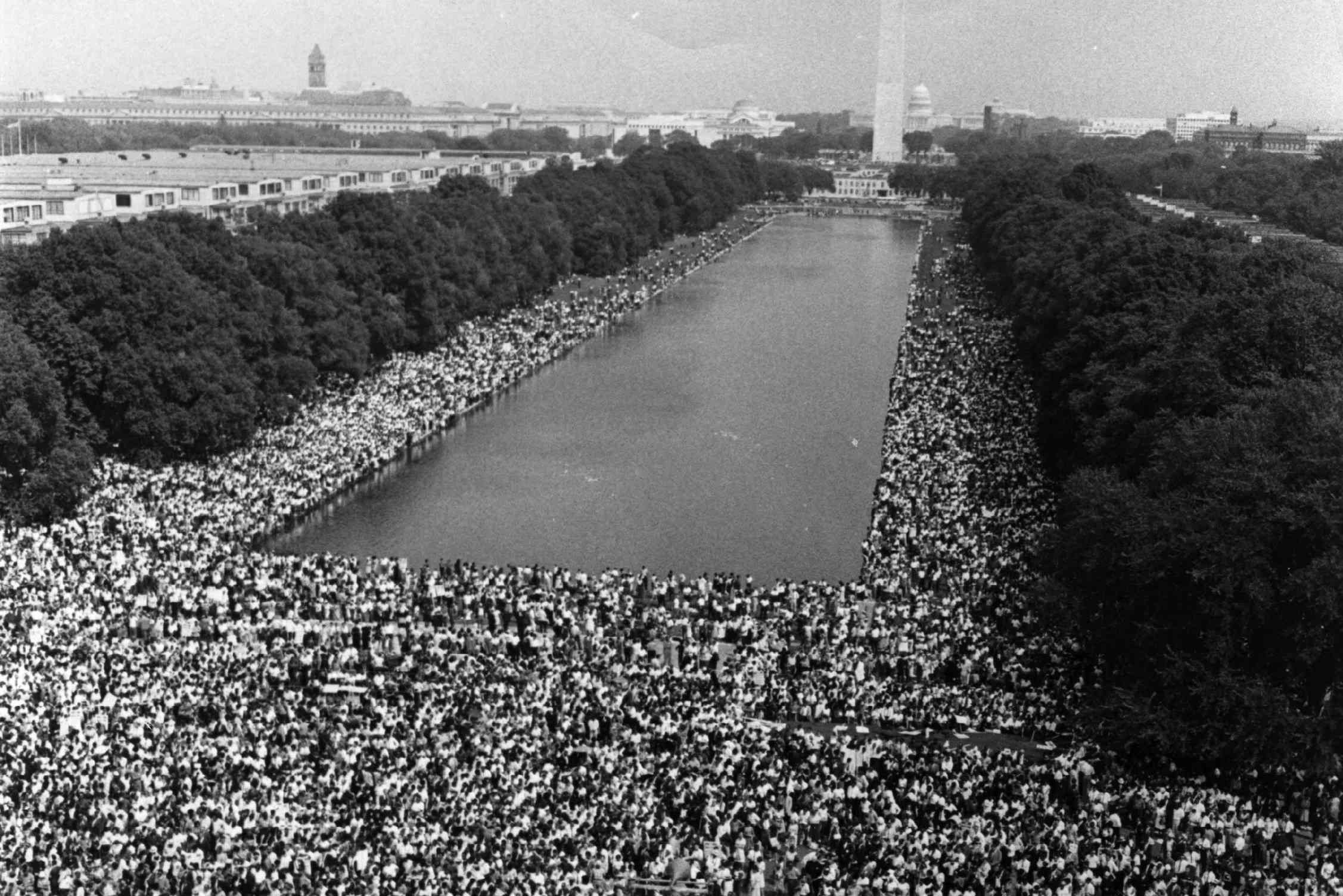 Thousands of people crowded in front of the Washington Monument Reflecting Pool during the March on Washington for Jobs and Freedom