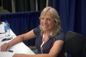 Ellen Hopkins signing autographs at an event.
