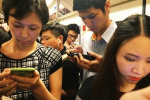 People looking at phones, ignoring each other on subway.