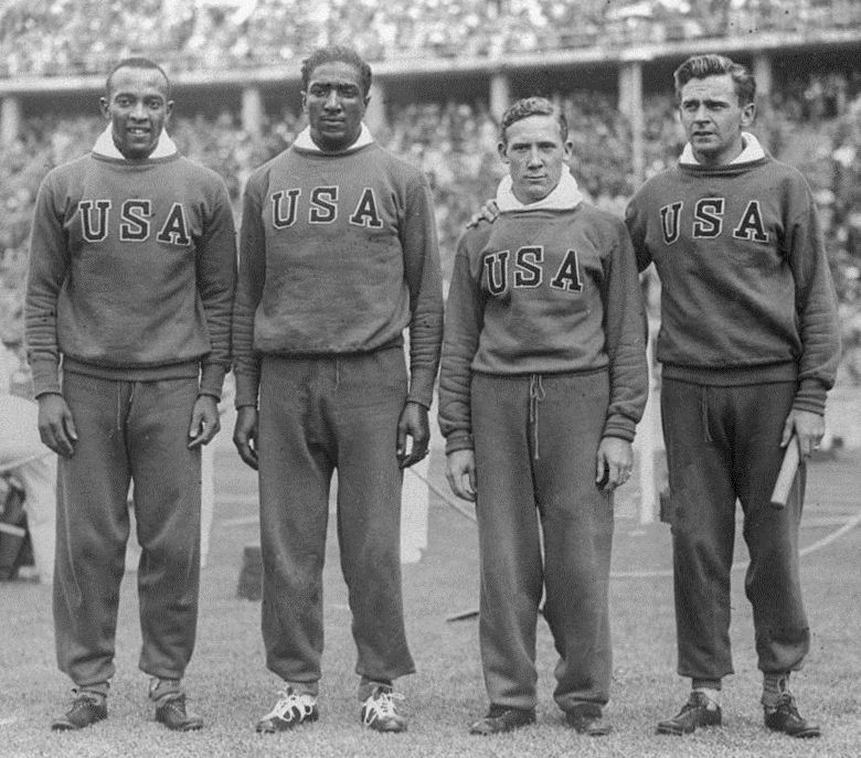 Jesse Owens (left), Ralph Metcalfe (second left), Foy Draper (second right) and Frank Wykoff (right)the USA 4x100 metres Relay Team at the 1936 Olympic Games