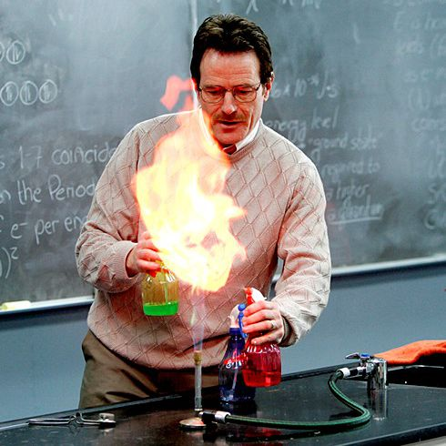 Walt changes the colors of a flame by spraying it with chemicals.