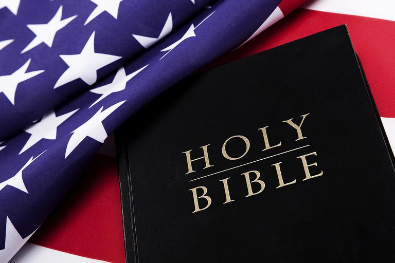 A holy bible on an American flag