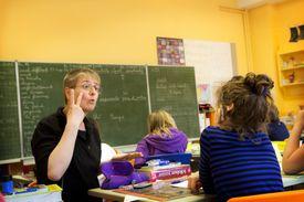 teacher talking to deaf student