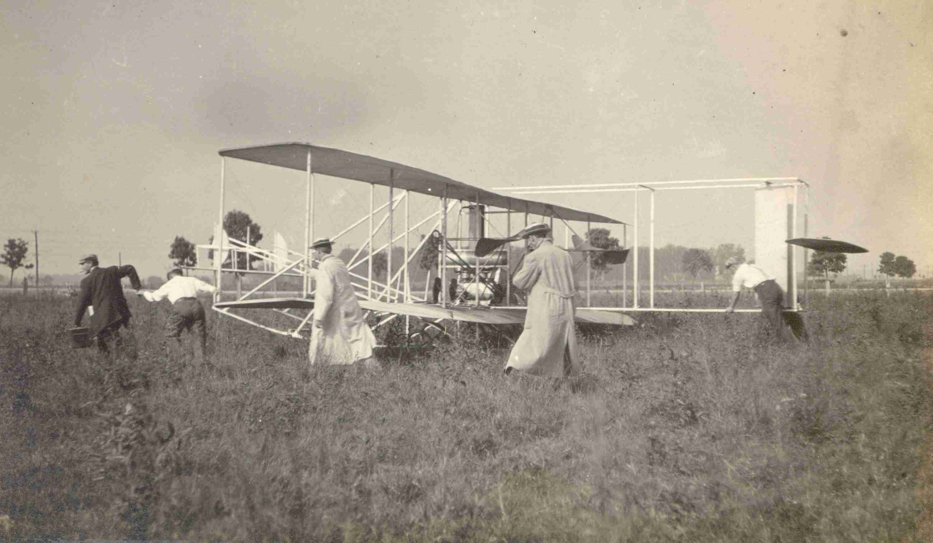 Students moving Wright B flyer at Huffman Prairie Flying Field