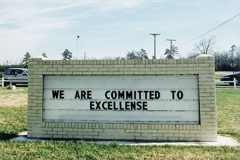 "A sign that says ""We are committed to excellense"""