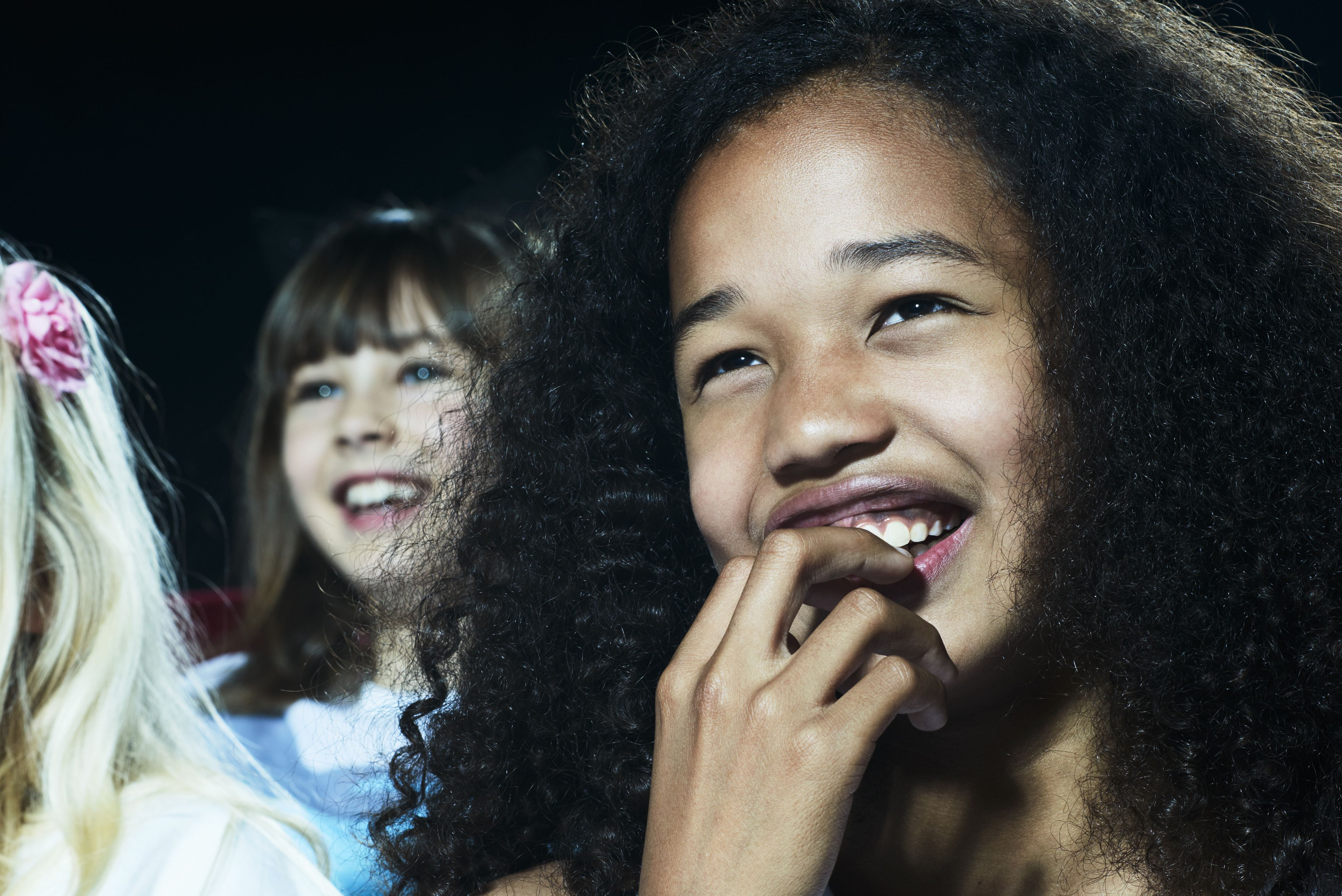 Portrait Of Girl Watching A Movie At The Cinema