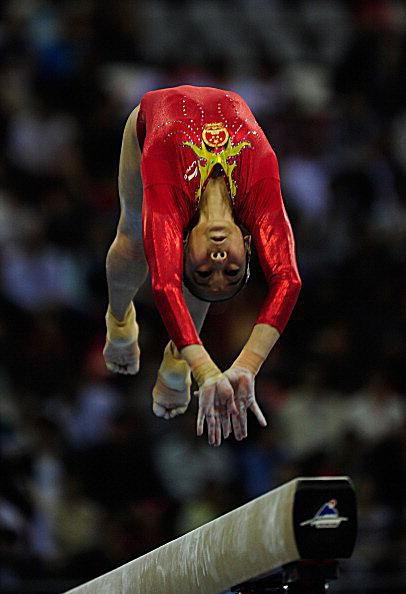 Chinese gymnast Deng Linlin on the beam at the 2010 Asian Games