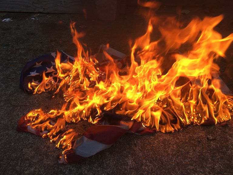 Close-up of burning American flag