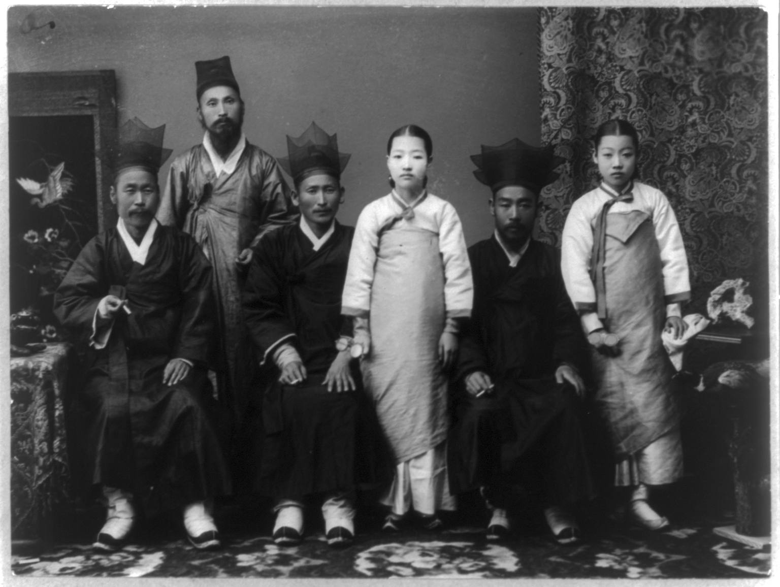 The men wear several different styles of traditional Korean hats.