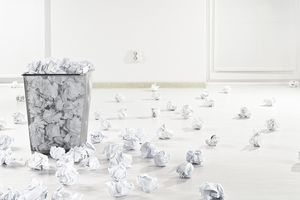 Many crumpled paper balls