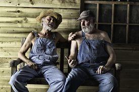 Two elderly Hillbillies gossiping