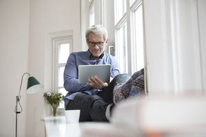 mature man using tablet