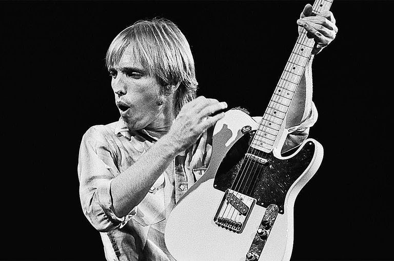 Singer Tom Petty, playing the guitar, performs on stage during a 1981 Chicago, Illinois, concert.