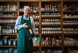 Italian man working in grocery shop