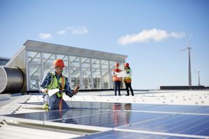 Engineer testing solar panels at sunny power plant