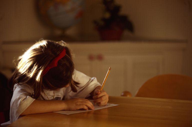 Girl doing homework, sitting at table