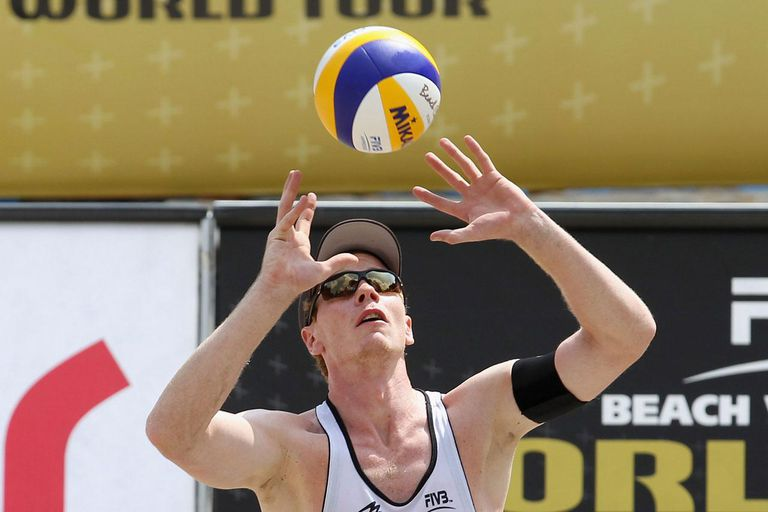BERLIN, GERMANY - AUGUST 08: Markus Boeckermann of Germany sets the ball during a match between Germany and USA on day three of the Berlin Smart Grand Slam of FIVB World Tour at Waldbuehne on August 8, 2013 in Berlin, Germany.