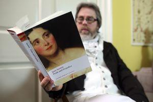 Man reading Pride and Prejudice