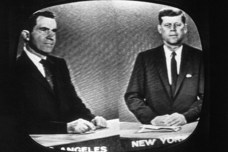 Nixon and JFK debate on TV black and white image.