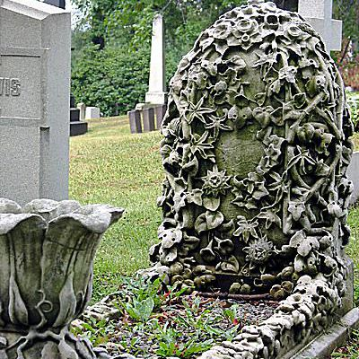 Vining ivy and flowers are carved in relief on this tombstone
