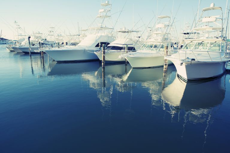 Yachts docked at harbor