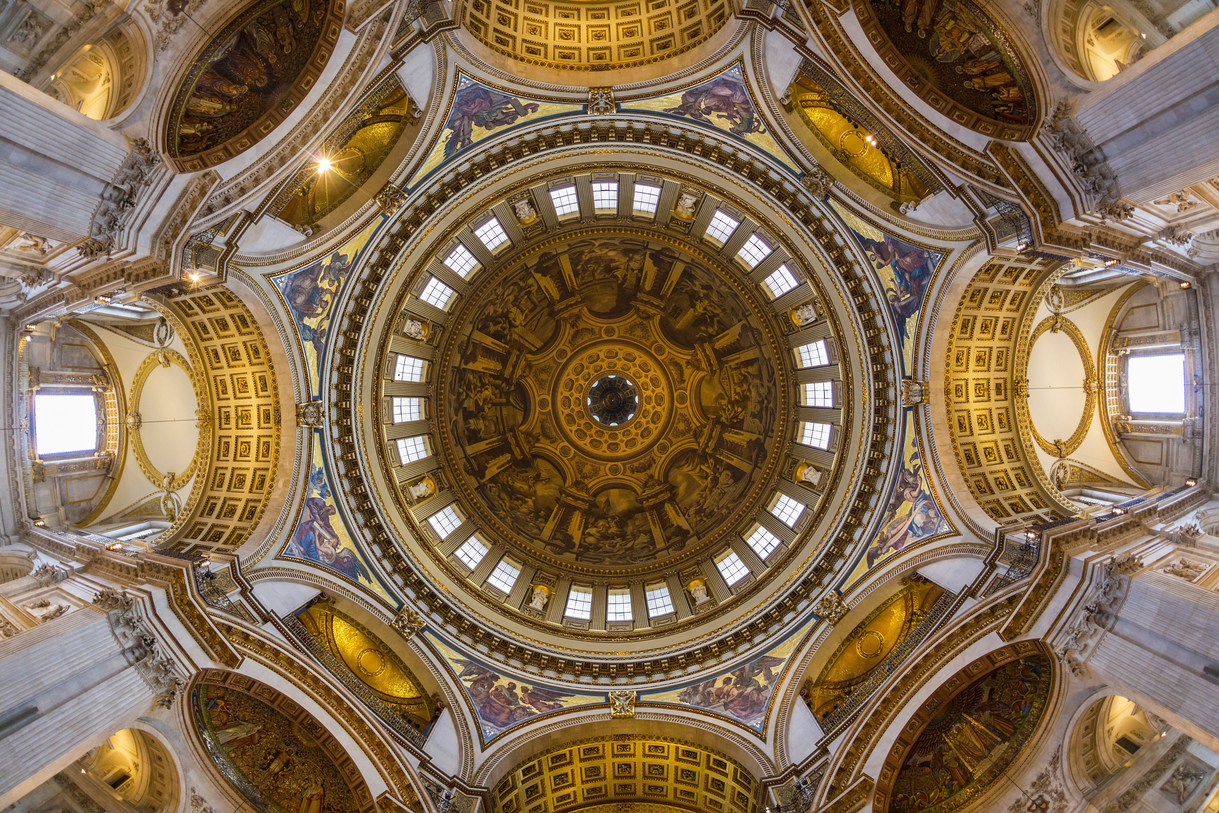interior, looking up at ornate interior of dome, windows around bottom, window areas surrounding dome windows
