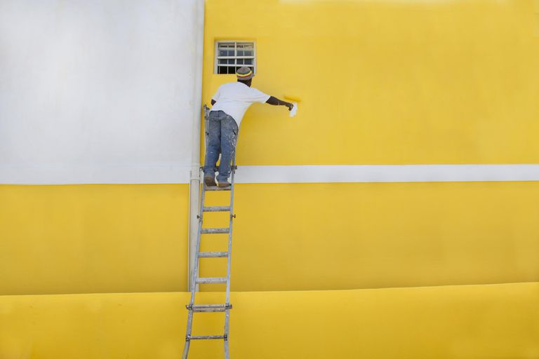 Man painting a house