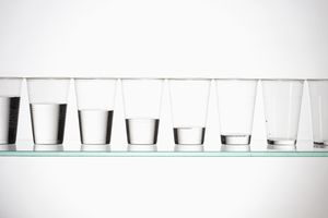 A series of glasses with differing amounts of liquid in them