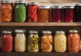 Home Canning, Preserving, Pickling Food Stored on Wooden Storage Shelves