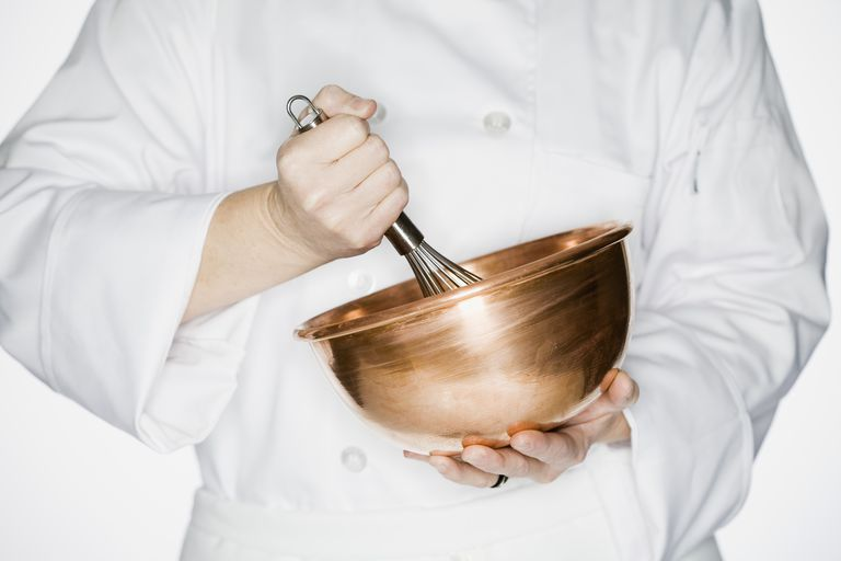 A Chef Whisking in a Copper Bowl