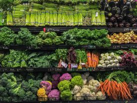 Various fresh vegetables on the shelves at the grocery store.